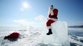 Santa Claus Riding the Ice Knight. Christmas holidays, Santa Claus walks around the lake Baikal, Siberia, Russia stock footage
