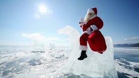 Santa Claus Riding the Ice Knight. Christmas holidays, Santa Claus walks around the lake Baikal, Siberia, Russia stock video footage