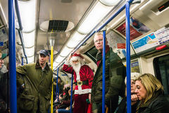Santa Claus riding the London tube, Christmas week 2013 Stock Images