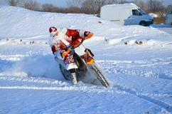 Santa Claus riding on a motorcycle turning MX Royalty Free Stock Photography