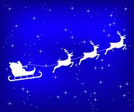 Santa Claus riding reindeer on a blue shiny Christmas background vector illustration