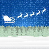 Santa Claus riding on a reindeer Royalty Free Stock Photography