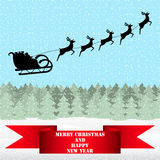 Santa Claus riding on a reindeer Royalty Free Stock Images