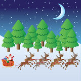 Santa Claus riding in sleigh with deers. Santa Claus with christmas elf and presents in sleigh with deers riding through winter forest Royalty Free Stock Photo