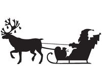 Santa Claus riding a sleigh with reindeer. Silhouette image of Santa Claus riding a sleigh with reindeer Royalty Free Stock Photography