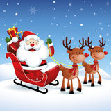 Santa Claus riding a sleigh with Reindeers in Christmas Stock Image