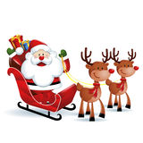 Santa Claus riding a sleigh with Reindeers Royalty Free Stock Image