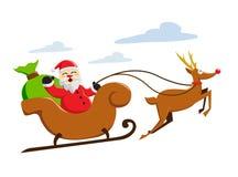 Santa claus riding snow sleigh Stock Photo
