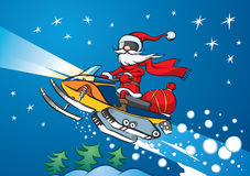 Santa Claus riding on snowmobile Stock Photos