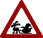 Santa Claus Road Sign. Red triangle with a black silhouette of Santa Claus in his sleigh and one reindeer within, against white.  Everything isolated against a Stock Photography