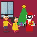 Santa Claus Robot giving gifts to children near the Christmas tree at home. Royalty Free Stock Photography