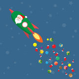 Santa claus on rocket drop presents Stock Photography