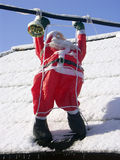 Santa Claus on a roof Royalty Free Stock Image