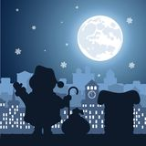 Santa Claus on a roof on a background a nightly festive city. On the image presented Santa Claus on a roof on a background a nightly festive city Royalty Free Stock Photos