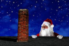 Santa Claus on the roof Stock Images