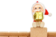 Santa Claus on roof holding a gift Stock Photography