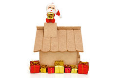 Santa Claus on roof holding a gift Royalty Free Stock Photos