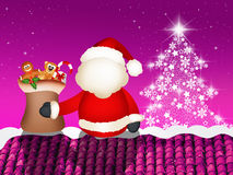 Santa claus on roof Royalty Free Stock Image
