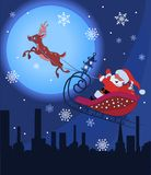 Santa Claus and Rudolf in Christmas night Royalty Free Stock Photography
