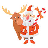 Santa Claus and Rudolph. Santa Claus with reindeer and candy cane Royalty Free Stock Photo