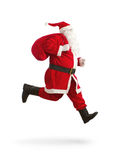 Santa Claus on the run. To delivery christmas gifts isolated on white background stock photo