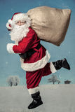 Santa Claus running Stock Photo