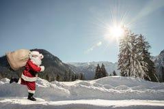 Santa Claus running Royalty Free Stock Photography