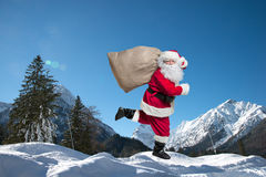 Santa Claus running. With the bag of the presents Royalty Free Stock Photo