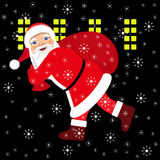 Santa Claus running with the bag of the presents. Royalty Free Stock Image