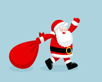 Santa Claus running with the bag of the presents Stock Photography