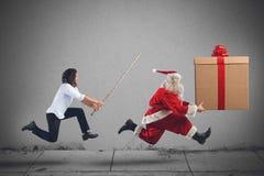 Santa Claus running. A dangerous men chasing Santa Claus running Royalty Free Stock Images