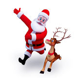 Santa claus running with reindeer Royalty Free Stock Photo