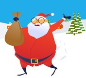 Santa Claus running through the snow with a toy ba Royalty Free Stock Photo