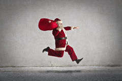 Santa Claus. Running to deliver his gifts stock photography