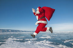 Santa Claus running in the winter Royalty Free Stock Image