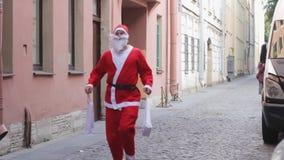Santa claus runs sale gifts funny christmas new year celebration. Black friday stock video
