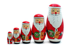 Santa Claus Russian Nesting Do. A Procession of Wooden Santa Claus Russian Nesting Dolls Royalty Free Stock Photos