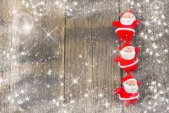 New Year`s decorations, rustic,  blue and white. Santa Claus on a rustic wooden background with a snowflakes and stars Royalty Free Stock Photos