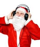 Santa claus słuchając muzyki zdjęcie royalty free
