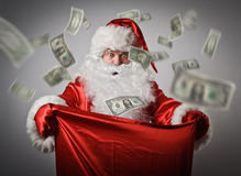Santa Claus and sack with dollars.
