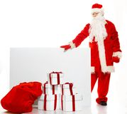 Santa Claus with sack full of gift boxes Royalty Free Stock Photos
