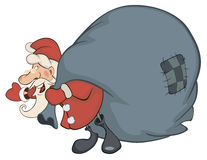 Santa Claus and a sack full of gifts Stock Image
