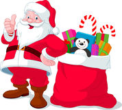 Santa Claus with sack full of gifts Stock Photos