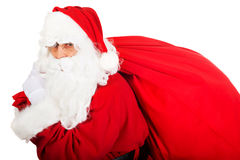 Santa Claus with sack full of presents Royalty Free Stock Images