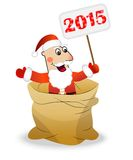 Santa claus in a sack holds a banner with numbers 2015 year Royalty Free Stock Photo