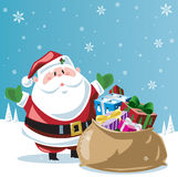 Santa Claus and sackful of toys Stock Image