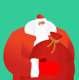 Santa Claus with sackful toys and sweets. Big red festive bag. G Royalty Free Stock Photo