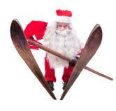 Santa Claus salta en los esquís Foto de archivo libre de regalías