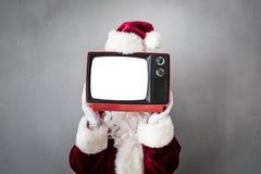 Santa Claus. Holding retro TV with screen blank. Christmas Xmas holiday concept stock photos