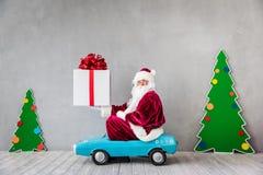 Santa Claus. Riding car. Christmas Xmas holiday concept Stock Photo